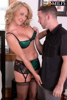 Lusty cougar Cali Houston shows off her sexy body to a young stud