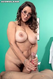 Senior sex star Persia Monir plays the naughty nurse in a hot new DVD from Scoreland.Com
