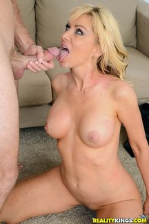 Beautiful blond MILF star Sasha Sean eats cum at milfhunter.com