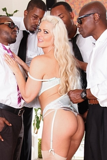 MILF porn star Holly Heart services four big black cocks in a new DVD from devilsFilm.com