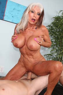 Over sixty porn star Sally D'Angelo rides a big dick