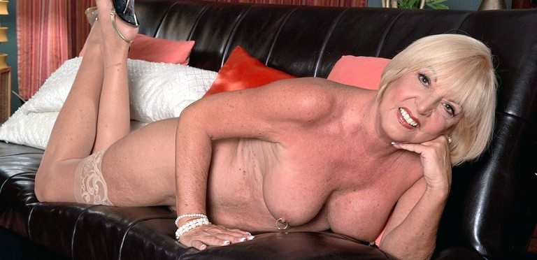 Gorgeous granny Scarlet Andrews is a sexy senior swinger
