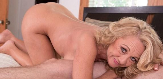 Sexy senior Cali Houston seduces a young stud at 50PlusMILFs.Com
