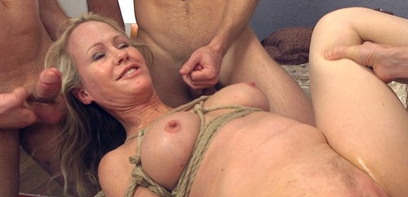 Mature sex star Simone Sonay gets an extreme gang bang from five young horny studs.