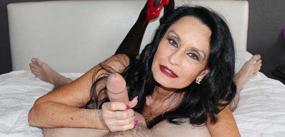 Senior sex star Rita Daniels in stockings garter belt and a fresh manicure