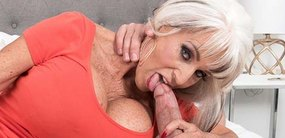 Legendary MILF sex star Sally D'Angelo is back to work over two huge cocks